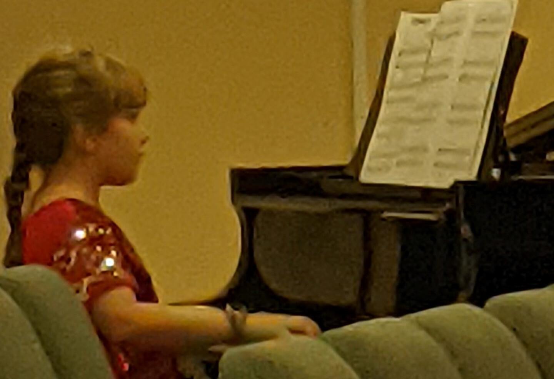 Grace playing piano